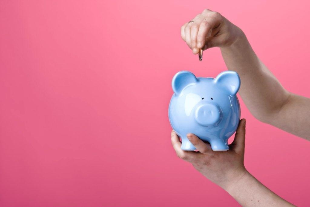 Retirement income planning - blue piggy bank saving