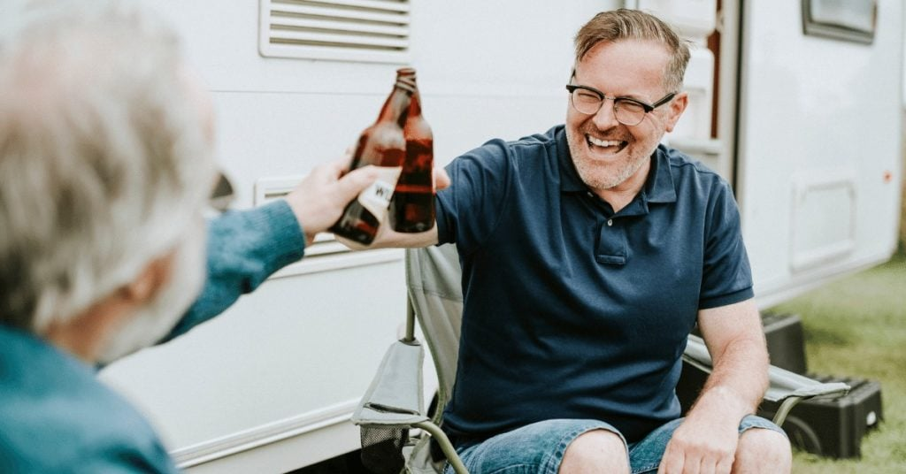 Can I take my pension at 55 and still work? man enjoying his early retirement
